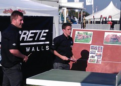 uys playing outdoor table tennis tables